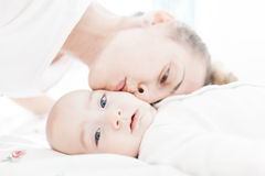 Loving mom and her son. Affectionate mom kissing her baby boy Stock Images