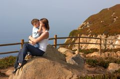 Loving moment. Between mother and son playing together outdoors Royalty Free Stock Images