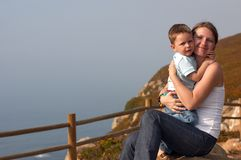 Loving moment. Between mother and son playing together outdoors Royalty Free Stock Photography