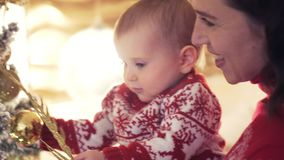 Loving mother and baby daughter celebrating Christmas stock footage