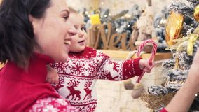 Loving mother and baby daughter celebrating Christmas stock video footage