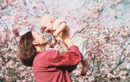 Mother and baby girl on nature at springtime stock photos