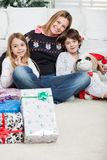 Loving Mother With Children During Christmas Stock Photos