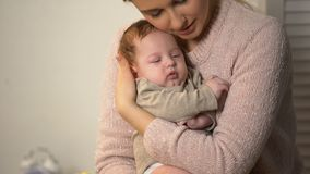 Loving mother cuddling little baby tenderly, newborn healthcare and patronage. Stock footage stock video