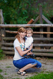 Loving mother and cute son at village Stock Photography