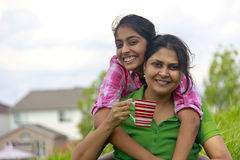 Loving mother daughter enjoying in park. Cheerful mother and daughter enjoying outdoors Royalty Free Stock Images