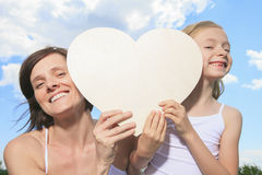 Loving mother and daughter, holding a heart shaped Royalty Free Stock Image