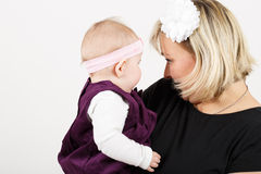 Loving mother embracing her baby girl Stock Photography