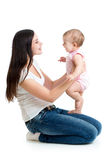 Loving mother having fun with baby Stock Photos