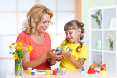 Loving mother and her child painting easter eggs. Loving mother and her child coloring easter eggs Stock Photography