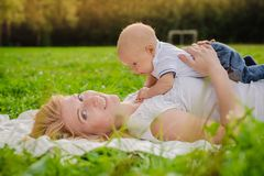 Loving mother with her newborn baby on her arms. stock photography