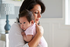 Free Loving Mother Holding Baby Daughter At Home Royalty Free Stock Photos - 71523838