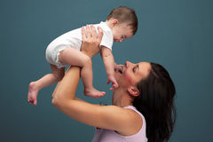 Loving mother holding baby - studio shot Royalty Free Stock Photos