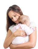 Loving mother hugging her baby isolated Royalty Free Stock Photo