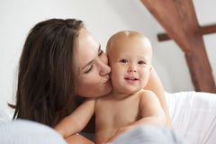 Loving mother kissing child Royalty Free Stock Images
