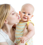Loving mother kissing her child on white background. Mother holding her child on white background Stock Photo
