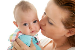 Loving mother kissing her little daughter Royalty Free Stock Photos