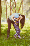 Loving mother kissing her son. Loving mother kissing her attractive young son on the cheek. Toned image Stock Photos