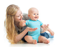 Loving mother playing with baby boy  on white Stock Image