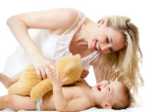 Loving mother playing with her baby;. Mother playng with her smiling baby Royalty Free Stock Photo