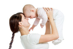 Loving mother playing with her child girl isolated Stock Images