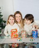 Loving Mother And Siblings With Christmas Presents Stock Photo
