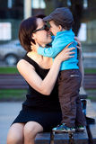 Loving mother and son hugging outdoors Royalty Free Stock Image
