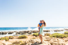 Loving mother and son hugging outdoors on beautiful summer day. Loving mother and son hugging outdoors on beautiful summer day Royalty Free Stock Images