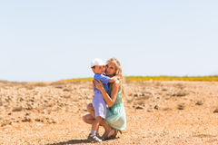 Loving mother and son hugging outdoors on beautiful summer day. Loving mother and son hugging outdoors on beautiful summer day Royalty Free Stock Photography