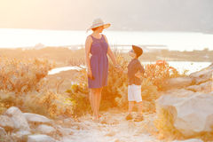 Loving mother and son outdoors on sunset Royalty Free Stock Image