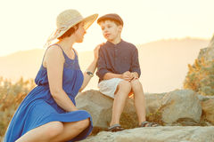 Loving mother and son outdoors on sunset Royalty Free Stock Photography
