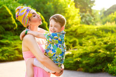 Loving Mother and son playing in summer park Stock Photography