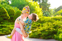 Loving Mother and son playing in summer park Stock Photos