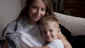 Loving mother and son. Portrait of loving mother and son relaxing at home stock video
