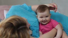 Loving mother stroking adorable baby girl head stock video