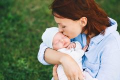 Free Loving Mother With Her Newborn Baby On Her Arms. Stock Photos - 112833373