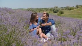 Loving multiethnic couple enjoying picnic outdoors stock footage