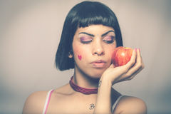 Loving nature. Young woman with apple. Stock Photo