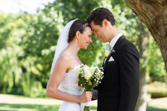 Loving newly wed couple in garden Royalty Free Stock Photo
