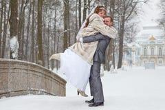 Loving newlywed couple walking Stock Image
