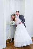 Loving newlywed in front of doors Stock Image