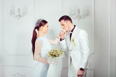 Loving newlyweds in trendy outfits stock photography