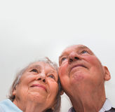 Loving older couple looking up with a smile Royalty Free Stock Photo