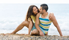 Loving pair having romantic date on sandy beach Stock Image