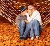 Loving pair kissing in hammock Royalty Free Stock Photos