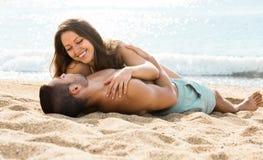 Loving pair  on sand beach Stock Image