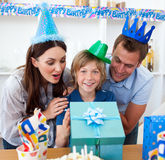 Loving parents celebrating their son's birthday Royalty Free Stock Image