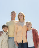 Loving Parents And Children Standing Against Clear Blue Sky Royalty Free Stock Images