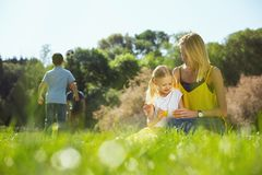 Loving parents playing with their kids outdoors Royalty Free Stock Image
