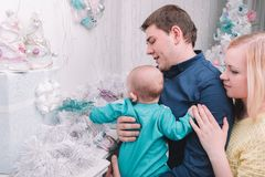 Loving parents show their baby Christmas gifts. The concept of Christmas stock photo